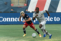 FOXBOROUGH, MA - SEPTEMBER 23: Victor Wanyama #2 of Montreal Impact dribbles as Kelyn Rowe #11 of New England Revolution defends during a game between Montreal Impact and New England Revolution at Gillette Stadium on September 23, 2020 in Foxborough, Massachusetts.