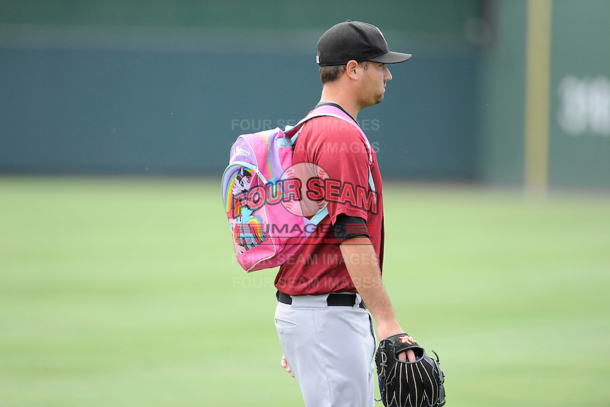 """Pitcher John Mincone (25) of the Savannah Sand Gnats totes the snacks to the bullpen in a pink """"My Little Pony"""" backpack before a game against the Greenville Drive on Sunday, August 24, 2014, at Fluor Field at the West End in Greenville, South Carolina. Greenville won, 8-5. (Tom Priddy/Four Seam Images)"""