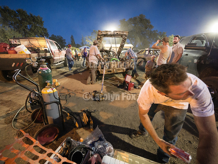 Day 4 of the Amador County Fair, Plymouth, Calif.<br /> Destruction Derby<br /> <br /> The mad scramble between heats of the Destruction Derby trying to get the cars ready for the next round.