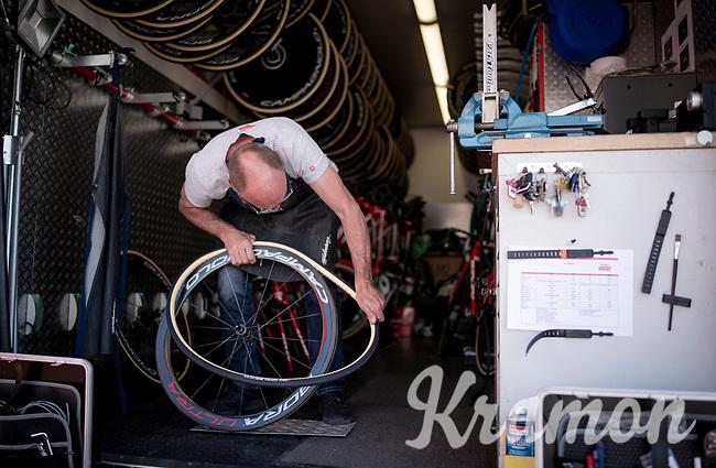 mechanic Jean-Pierre Christiaens at work in the teamtruck, puting on some fresh rubber<br /> <br /> Stage 21 (ITT): Verona to Verona (17km)<br /> 102nd Giro d'Italia 2019<br /> <br /> ©kramon