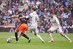 Real Madrid's Sergio Ramos and Carlos Henrique Casemiro and Valencia CF's Munir El Haddadi during La Liga match between Real Madrid and Valencia CF at Santiago Bernabeu Stadium in Madrid, April 29, 2017. Spain.<br /> (ALTERPHOTOS/BorjaB.Hojas)