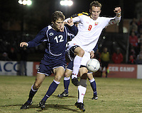 Jason Herrick #9 of the University of Maryland moves the ball away from Andy Parr #12 of Penn State during an NCAA 3rd. round match at Ludwig Field, University of Maryland, College Park, Maryland on November 28 2010.Maryland won 1-0.