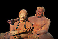 Close up of 6th century BC Etruscan Sarcophagus known as The Sarcophagus of the Spouses, the in sculpted in clay by the sculptors of Caere, 520-510 BC, Louvre Museum, Paris. Black background. To license for non editorial Advertising usage contact The Louvre Paris