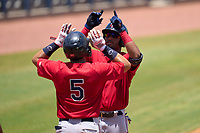 FCL Twins Malfrin Sosa (35) celebrates hitting a home run with Yonardy Soto (5) during a game against the FCL Rays on July 20, 2021 at Charlotte Sports Park in Port Charlotte, Florida.  (Mike Janes/Four Seam Images)