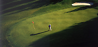 Aerial view of a golfer on the 13th hole of the Awbrey Glen Course. Bend, Oregon.