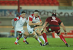 Ulster lock Neil McComb takes on Scarlets flanker George Earle..Celtic League.Scarlets v Ulster.Parc y Scarlets.02.12.12..©Steve Pope