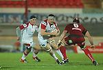 Ulster lock Neil McComb takes on Scarlets flanker George Earle..Celtic League.Scarlets v Ulster.Parc y Scarlets.02.12.12..©Steve Pope