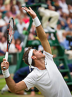 London, England, 01 July, 2016, Tennis, Wimbledon, Juan Martin Del Potro (ARG) serves in his match against Stanislas Wawrinka (SUI)<br /> Photo: Henk Koster/tennisimages.com