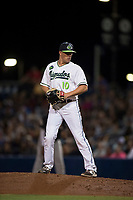 Hillsboro Hops relief pitcher Travis Moths (10) gets ready to deliver a pitch during a Northwest League game against the Salem-Keizer Volcanoes at Ron Tonkin Field on September 1, 2018 in Hillsboro, Oregon. The Salem-Keizer Volcanoes defeated the Hillsboro Hops by a score of 3-1. (Zachary Lucy/Four Seam Images)