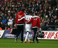 Wednesday, 01 January 2014<br /> Pictured: Pablo Hernandez of Swansea (C) is helped off the pitch by team physios after suffering a suspected hamstring injury.<br /> Re: Barclay's Premier League, Swansea City FC v Manchester City at the Liberty Stadium, south Wales.