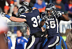 Nevada's Nick Hale (32) and Stefphon Jefferson (25) celebrate after Jefferson scored against Boise State in the second half of an NCAA college football game on Saturday, Dec. 1, 2012,  in Reno, Nev. Boise State won 27-21. (AP Photo/Cathleen Allison)