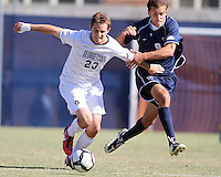 Ben Slingerland #23 of Georgetwn University tries to get away from Dylan Renna #9 of Villanova University during a Big East match at North Kehoe Field, Georgetown University on October16 2010 in Washington D.C. Georgetown won 3-1.
