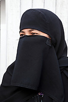 India, Dehradun.   Veiled Muslim Indian Woman.  Photographed with permission, but without Model Release.