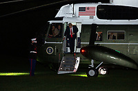 United States President Donald J. Trump walks off Marine One on the South Lawn of the White House in Washington D.C., U.S., on Wednesday, June 24, 2020 after returning from a day trip to Arizona.  Credit: Stefani Reynolds / CNP/AdMedia