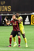 ATLANTA, GA - AUGUST 22: Erick Torres #31, Jalil Anibaba #3 wrestle over possession of the ball during a game between Nashville SC and Atlanta United FC at Mercedes-Benz Stadium on August 22, 2020 in Atlanta, Georgia.