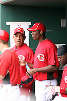 Aroldis Chapman. Cincinnati Reds. Chapman, who left his native Cuba to sign with the Reds, appears in his first spring training game against the Kansas City Royals at Goodyear, AZ - 03/08/2010. Chapman is discussing his scoreless two-inning stint with pitching coach Mario Soto (left)..Photo by:  Bill Mitchell/Four Seam Images.