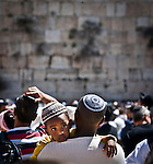 An Ethiopian arrives at the wailing wall Judaism most Holy site in Jerusalem Thursday March 28 2013. Thousands of Jewish worshipers gathered in Jerusalem to take part in  the tri-annual blessing of the Jewish people by members of the Jewish priestly caste at the Wailing Wall in Jerusalem. Jews named Cohen, considered descendants of the Temple's high priest, have the special duty of blessing the congregation three times a year.  Photo by Eyal Warshavsky.