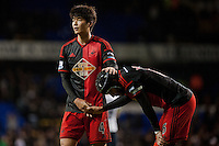 LONDON, ENGLAND - MARCH 04:  Ki Sung-Yueng of Swansea City  consoles Ashley Williams after the fnal whistle at  the Premier League match between Tottenham Hotspur and Swansea City at White Hart Lane on March 4, 2015 in London, England.  (Photo by Athena Pictures )