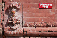 Kathmandu, Nepal.  Hindu god carved in stone in neglected neighborhood temple.