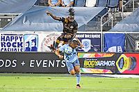 KANSAS CITY, UNITED STATES - AUGUST 25: Alberth Elis #7 of Houston Dynamo goes over the back of Winston Reid #22 of Sporting Kansas City  a game between Houston Dynamo and Sporting Kansas City at Children's Mercy Park on August 25, 2020 in Kansas City, Kansas.
