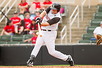 Dan Black #40 of the Kannapolis Intimidators connects for an RBI single to give the Intimidators a 6-5 lead over the West Virginia Power at Fieldcrest Cannon Stadium on April 20, 2011 in Kannapolis, North Carolina.   Photo by Brian Westerholt / Four Seam Images