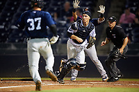 Tampa Tarpons catcher Kellin Deglan (25) fields a throw as Andres Sthormes (37) scores a run with Isaac Paredes (background) directing traffic and umpire Brandon Mooney looking on during the second game of a doubleheader against the Lakeland Flying Tigers on May 31, 2018 at George M. Steinbrenner Field in Tampa, Florida.  Lakeland defeated Tampa 3-2.  (Mike Janes/Four Seam Images)