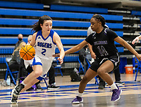 Aubrey Treadwell (2) of Rogers drives to the basket, as Wynter Beck (14) of Fayetteville trys to stop her at King Arena, Rogers, AR January 8, 2021 / Special to NWA Democrat-Gazette/ David Beach