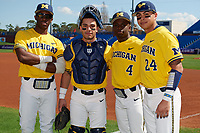 Michigan Wolverines Christan Bullock (5), Marcus Chavez (12), Ako Thomas (4), and Hector Gutierrez (24) pose for a photo before a game against Army West Point on February 17, 2018 at Tradition Field in St. Lucie, Florida.  Army defeated Michigan 4-3.  (Mike Janes/Four Seam Images)