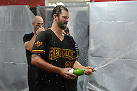 Rochester Red Wings pitcher Aaron Thompson (27) celebrates in the locker room after defeating the Scranton Wilkes Barre RailRiders on September 2, 2013 at Frontier Field in Rochester, New York to clinch the International League Wild Card Playoff spot.  (Mike Janes/Four Seam Images)