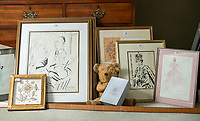 BNPS.co.uk (01202 558833)<br /> Pic: PhilYeomans/BNPS<br /> <br /> The house contains sketches and designs, and even Ian Thomas's teddy bear.<br /> <br /> A remarkable 'timewarp' archive amassed by a dressmaker to the Queen has sold for over £100,000.<br /> <br /> The late Ian Thomas meticulously kept his fashion designs, letters, cards and photographs relating to the Queen at his home that was more like a museum. <br /> <br /> He helped design the Queen's coronation gown in 1953 as well as the powder blue outfit she wore for Charles and Diana's wedding in 1981.<br /> <br /> The lifelong bachelor passed away in 1993 and left his home and its contents to a florist he had been good friends with for 25 years.<br /> <br /> After she died in 2015 the property was inherited by a relative who also knew Mr Thomas well.<br /> <br /> She has now sold the contents at auction.