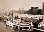 Pittsburgh PA:  Paddle Wheelers docked at the Monongahela Wharf. Water Street and Wabash Bridge in the background.