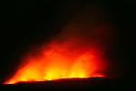 Lava steams as it hits the Pacific Ocean, Kilauea Volcano, Hawaii Volcanoes National Park, USA