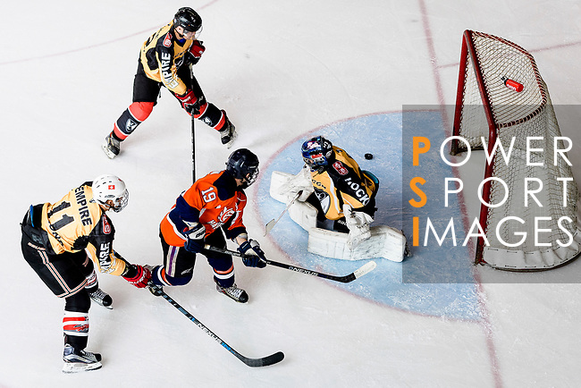 Sam Goodwin of Singapore Hawkers (C) Empire Goalie Eri Kiribuchi (R) fights for the puck with during the Mega Ice Hockey 5s match between Singapore Hawkers and Empire Skate on May 04, 2018 in Hong Kong, Hong Kong. Photo by Marcio Rodrigo Machado / Power Sport Images