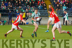 Jack Barry Na Gaeil goes past Luke Mullally Mullinahone in the Munster Junior Championship final on Sunday
