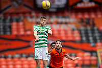 22nd August 2020; Tannadice Park, Dundee, Scotland; Scottish Premiership Football, Dundee United versus Celtic; Ryan Christie of Celtic wins the clearing header watched by Nicky Clark of Dundee United