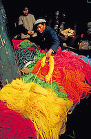 A merchant sells colored rope in Wuhan. Merchant. Wuhan, China.