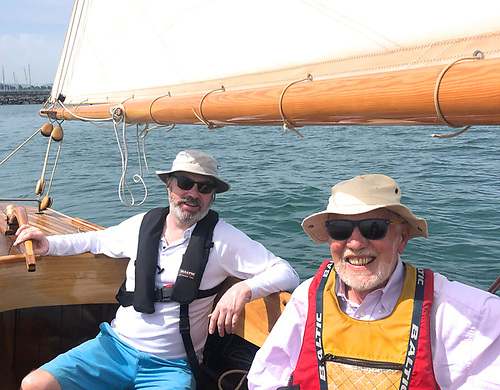 Walking the course……classics enthusiasts Guy Kilroy (left) and Hal Sisk testing the waters of Scotsman's Bay on Thursday of this week on board the former's 24ft 1896-built Boyd gaff sloop Marguerite, restored by Larry Archer. Photo: Ian Malcolm