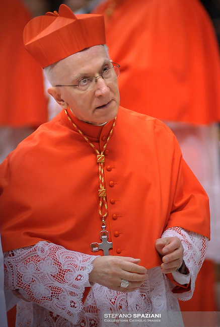 Italian newly appointed Cardinal Fortunato Baldelli (C) gets his biretta, the square red hat symbolising the blood of the martyrs, from Pope Benedict XVI (L) on November 20, 2010 during a consistory at St Peter's basilica at The Vatican. 24 Roman Catholic prelates join today the Vatican's College of Cardinals, the elite body that advises the pontiff and elects his successor upon his death