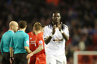 Bafetibis Gomis applauds the fans at the end of the Barclays Premier League Match between Liverpool and Swansea City played at Anfield, Liverpool on 29th November 2015