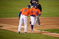 Syracuse Mets manager Tony DeFrancesco (11) congratulates Rene Rivera (44) after hitting a home run during an International League game against the Charlotte Knights on June 11, 2019 at NBT Bank Stadium in Syracuse, New York.  Syracuse defeated Charlotte 15-8.  (Mike Janes/Four Seam Images)