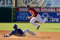 Nolan Fontana #5 of the Lancaster JetHawks avoids Casio Grider #11 of the Rancho Cucamonga Quakes during a play at second base at The Hanger on August 25, 2013 in Lancaster, California. Lancaster defeated Rancho Cucamonga, 7-1. (Larry Goren/Four Seam Images)