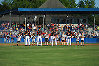 "Batavia Muckdogs players including Mike Garzillo (3), Kris Goodman (8), Samuel Castro (25) and J.J. Gould (49) stand with the ""Stars of the Game"" for the national anthem before a game against the State College Spikes on June 24, 2016 at Dwyer Stadium in Batavia, New York.  State College defeated Batavia 10-3.  (Mike Janes/Four Seam Images)"