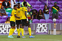 July 16th 2021; Orlando, Florida, USA;  Jamaica players celebrate their goal during the Concacaf Gold Cup match between Guadeloupe and Jamaica on July 16, 2021 at Exploria Stadium in Orlando, Fl.