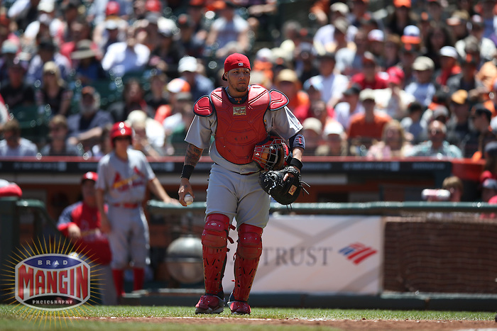 SAN FRANCISCO, CA - JULY 3:  Yadier Molina #4 of the St. Louis Cardinals works against the San Francisco Giants during the game at AT&T Park on Thursday, July 3, 2014 in San Francisco, California. Photo by Brad Mangin