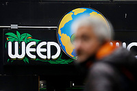 NEW YORK - NEW YORK - MARCH 25: A man walks near the Weed World Store on March 25, 2021 in New York. New York State reach a deal to legalize recreational marijuana, and open a way for a almost $4.2 billion industry that could create  thousands of jobs.. (Photo by Emaz/VIEWpress)