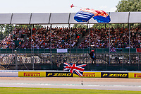 18th July 2021; Silverstone Circuit, Silverstone, Northamptonshire, England; Formula One British Grand Prix, Race Day; The RAF Falcons sky diving Trophy Drop before the Grand Prix land in front of the packed grandstands