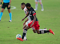 WASHINGTON, DC - SEPTEMBER 12: Jason Pendant #24 of the New York Red Bulls tries to move past Chris Odoi-Atsem #3 of D.C. United during a game between New York Red Bulls and D.C. United at Audi Field on September 12, 2020 in Washington, DC.