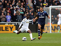 Pictured L-R: Nathan Dyer of Swansea against Mousa Dembele ofTottenham.  Saturday 30 March 2013<br /> Re: Barclay's Premier League, Swansea City FC v Tottenham Hotspur at the Liberty Stadium, south Wales.