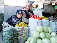 Woman selling vegetables and her son, Siyoh Bazar, Samarkand