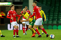 2nd January 2021; Carrow Road, Norwich, Norfolk, England, English Football League Championship Football, Norwich versus Barnsley; Teemu Pukki of Norwich City is closed down by Callum Styles and Mads Juel Andersen of Barnsley